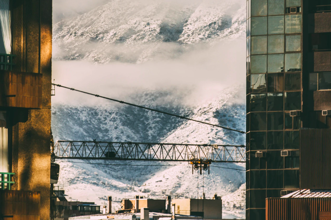 Construction by mountains in winter