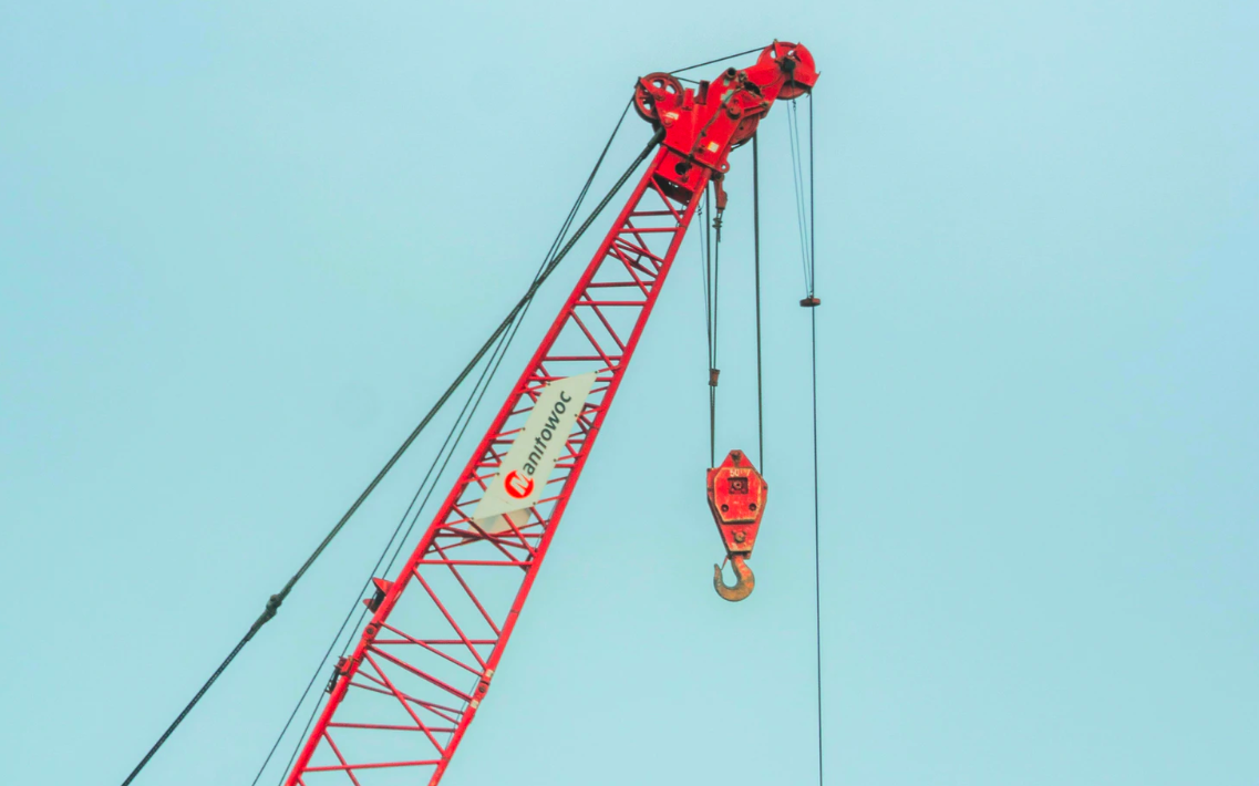 Red crane with pulley and hook